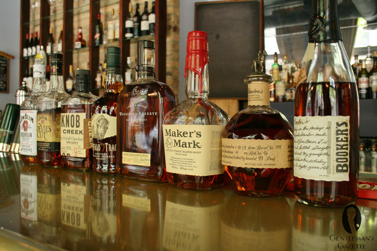 bottle of famous bourbon whiskey brands standing together on a table