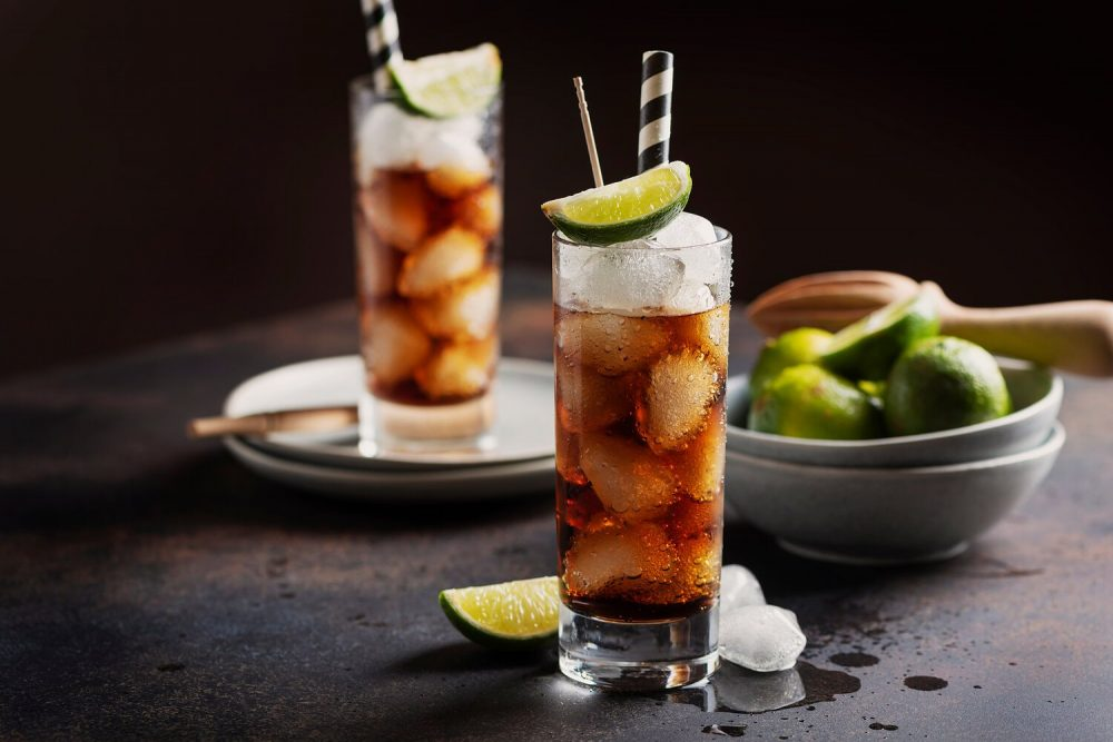 Cuba Libre long drink in two glasses on table