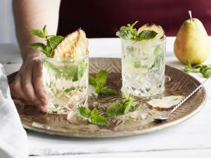 Gin and tonic with dried pear and fresh mint