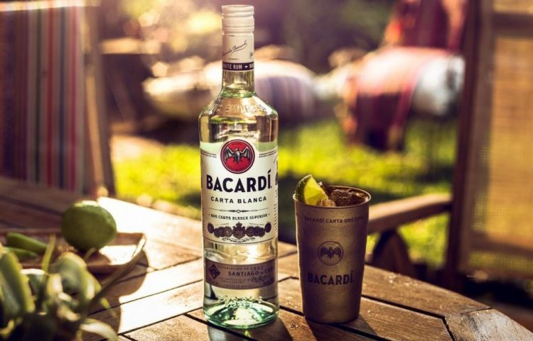 bacardi white rum and glass on table