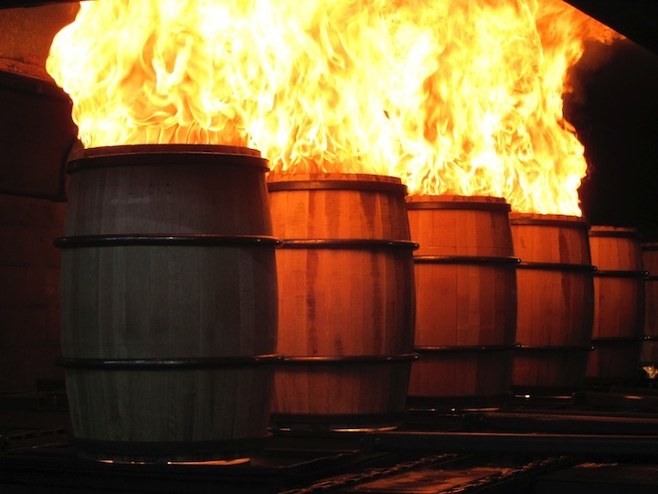 charring of barrels by setting them on fire