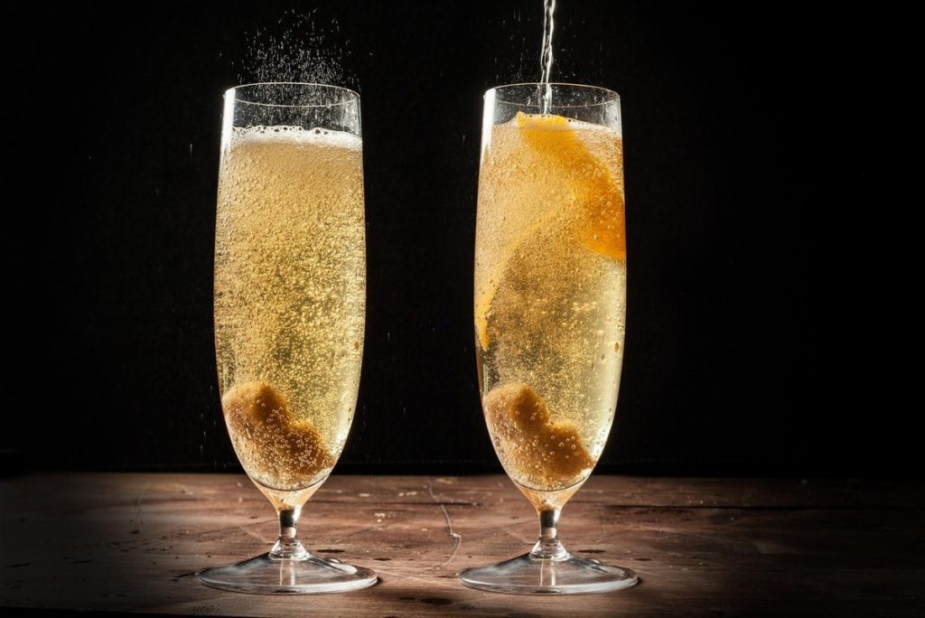 french 75 in two glasses with champagne bubbles clearly visible