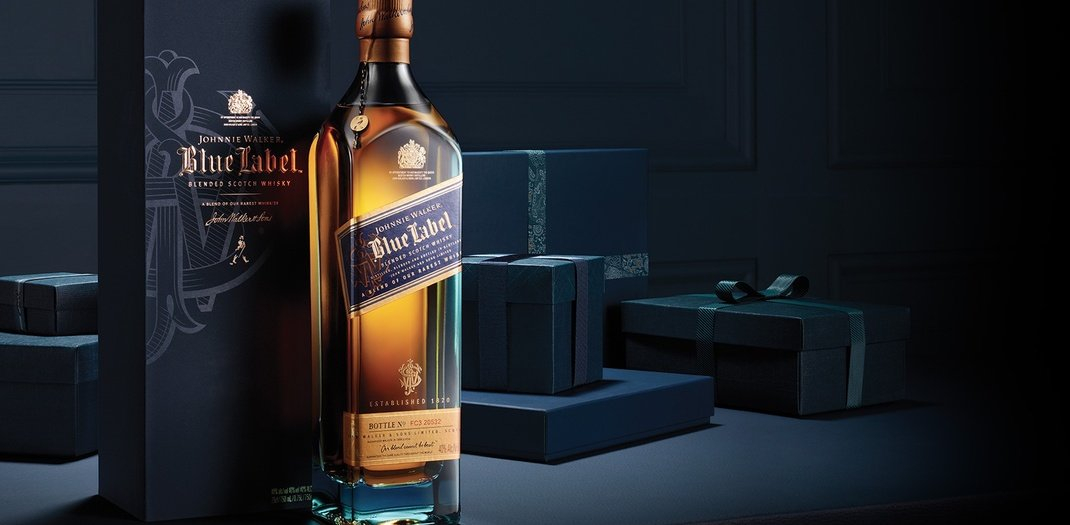 johnny walker blue label bottle in a dark setting