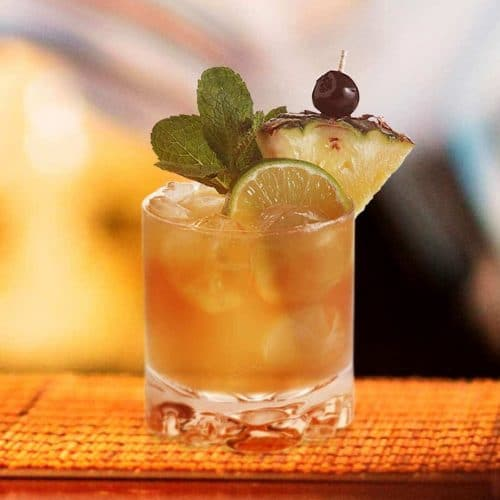 mai tai cocktail with pineapple wedge lime and mint garnish