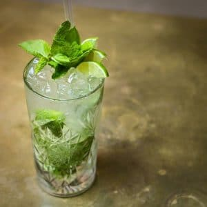Mojito rum and mint cocktail in a tall glass with mint garnish