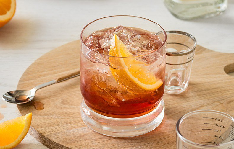 negroni cocktail on table with orange slice