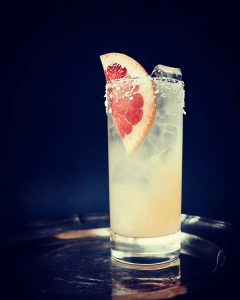 paloma cocktail in a glass with grapefruit garnish