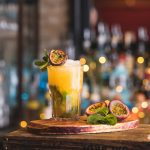 passion fruit mojito with passion fruit halves as garnish