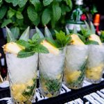 pineapple mojitos on a bar top