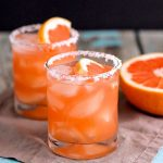 salty dog cocktail in glass with salt lick