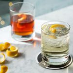 white negroni in a glass with orange zest
